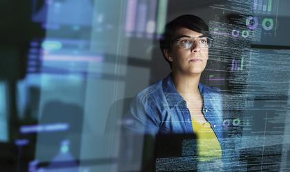 Woman Looking at Computer Algorithims iStock